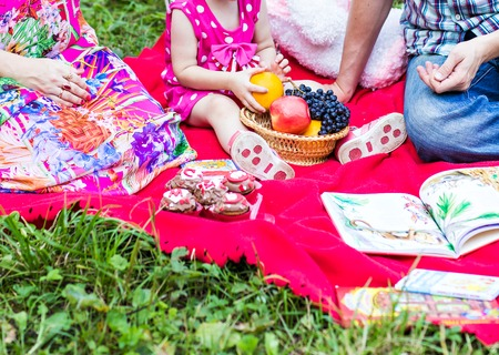 picnicking: Family  picnicking together, father, mother and daughter