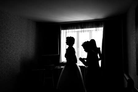 bridesmaids: silhouette of the Bride Dresses. with bridesmaids Stock Photo