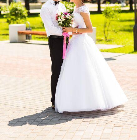 love in rain: Beautiful wedding couple is enjoying wedding day