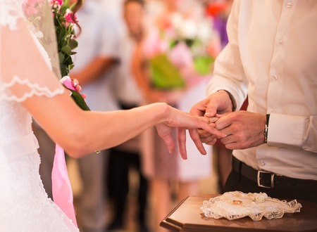 ear ring: Romantic scene from weeding celebration, wedding rings Stock Photo