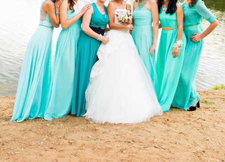 bridesmaids: bride and bridesmaids dressed in a blue dress