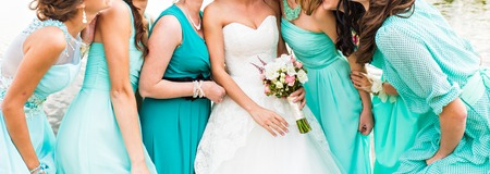 bride and bridesmaids dressed in a blue dress
