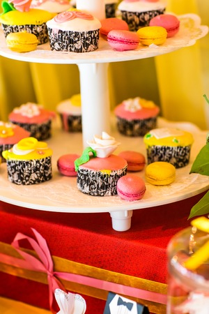 ombre cake: Dessert table for a party. cake and cupcakes