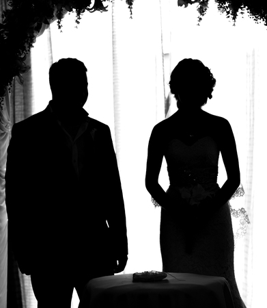 black girl smoking: silhouette of the bride and groom at a wedding.