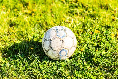 ballsport: Soccer ball on green field.  football game