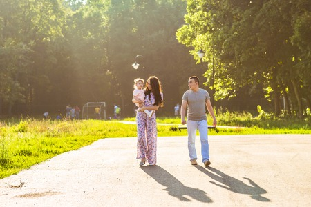 ethnic family: Happy Young Mixed Race Ethnic Family Walking In The Park. Stock Photo