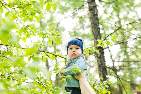 babygirl: cute baby-girl outdoors.  a child walks in the park Stock Photo
