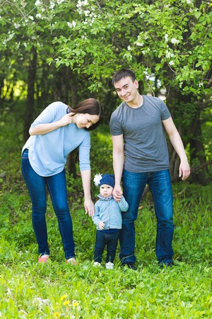 happy family nature: Happy young family spending time together in green nature. Stock Photo