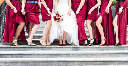 Row of bridesmaids  at wedding ceremony. Bride and bridesmaids