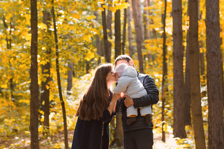 young leaves: portrait of a young family in the autumn park Stock Photo