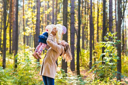 happy baby: happy mother and  little daughter playing on autumn walk