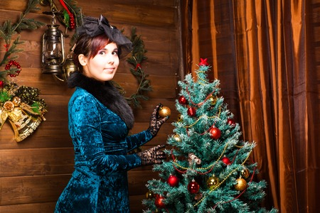 decorating christmas tree: Pretty young woman decorating Christmas tree. Christmas time Stock Photo