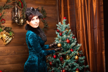 decorating christmas tree: Beautiful woman decorating christmas tree. New Year