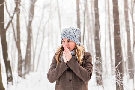 Portrait of a woman feeling cold in winter