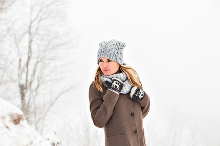 winter park: Pretty caucasian woman in a winter park Stock Photo