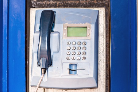 payphone: Public Payphone. blue phone box in a phone booth