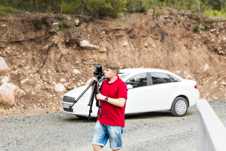 documenting: Professional on location and nature photographer photographing landscape  outdoor.