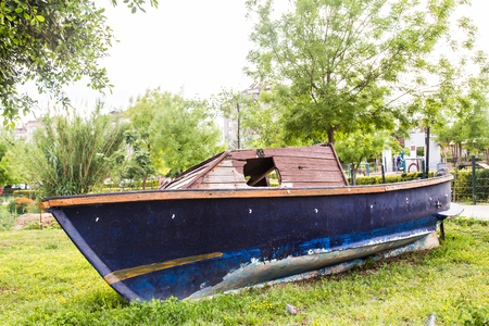 work boat: old boat in the park.  The boat does not work