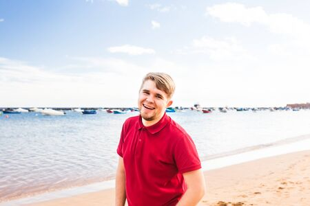 misfit: Smiling man at the seaside. Crazy happy man