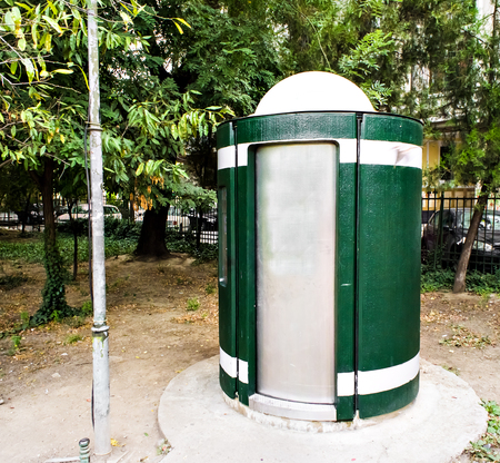 leases: Green Bio mobile toilet in a park