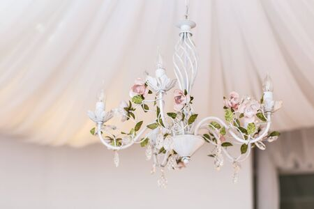diamond candle: chandelier in classic room shining.  room decor Stock Photo