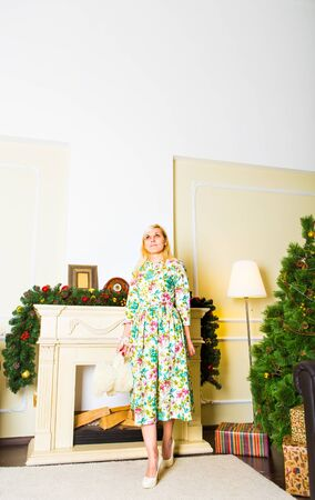 Young woman standing in front of Christmas tree Stock Photo