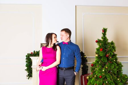 swapping: Young happy couple near  a Christmas tree. Stock Photo
