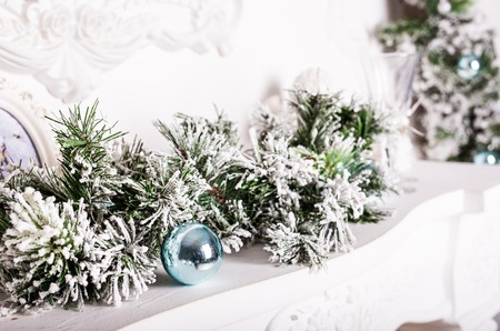 mantelpiece: Christmas decorations on the mantelpiece and fur-tree branch Stock Photo