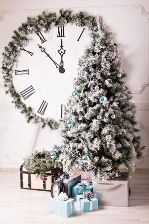 12 month old: Christmas clock and fir branches covered with snow Stock Photo