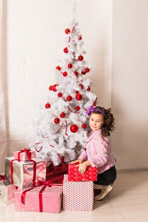 happy holidays: Happy child  with Christmas gift box. New year holidays