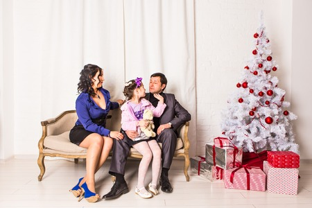 swapping: Family with gifts near  Christmas tree. Winter holidays, New Year Stock Photo