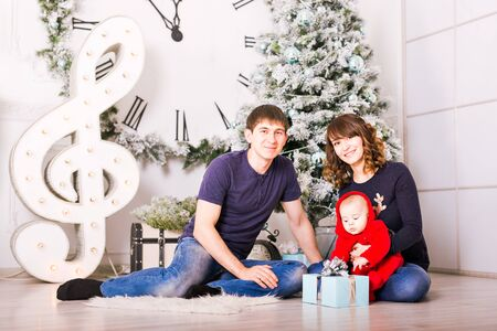 decorating christmas tree: Christmas Family Portrait In Home Holiday Living Room, House Decorating By Xmas Tree.