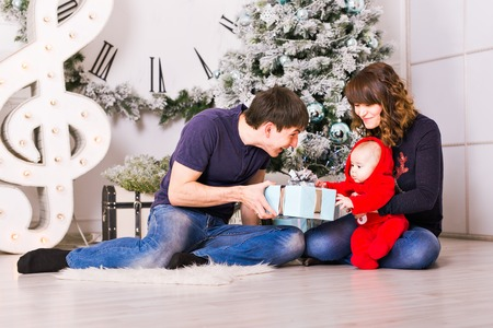 decorating christmas tree: Christmas Family Portrait In Home , House Decorating By Xmas Tree.