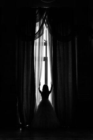 white door: Bride silhouette in front of high windows