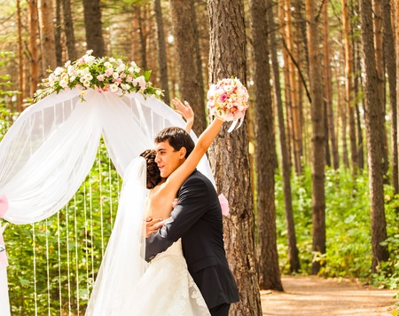Couple Getting Married at an Outdoor Wedding Ceremony.