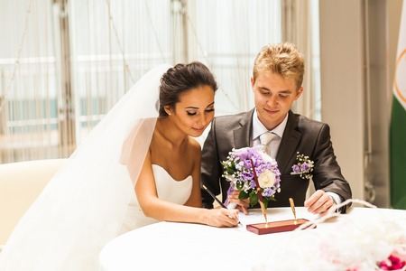 sanctity: Wedding ceremony. Wedding couple leaving their signatures Stock Photo