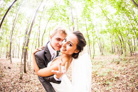 going crazy: Newlywed couple going crazy. Groom and bride together. Stock Photo
