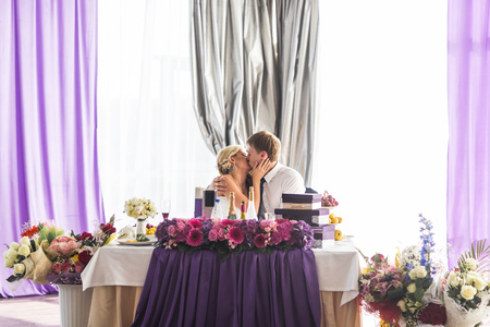 butonniere: Happy bride and groom on their  wedding reception. Stock Photo