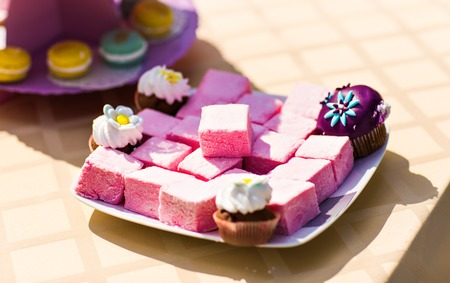 ombre cake: Sweet holiday buffet with cupcakes  and other desserts.