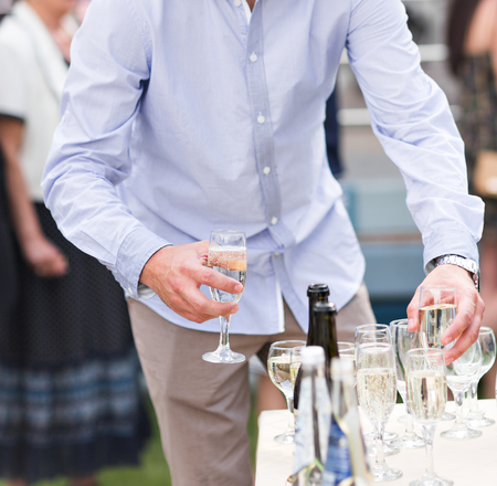 wedding guest: Wedding guest holding glass of champagne closeup. Stock Photo