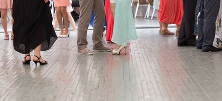 contemporary dance: feet of people dancing on  club party. unrecognizable