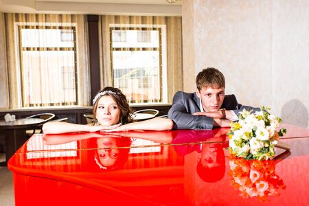sullenly: Wedding couple conflict, bad relationships. Bride and groom with angry expression