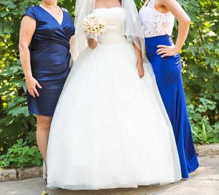 bridesmaid: bride and bridesmaid outside happy hug. Wedding