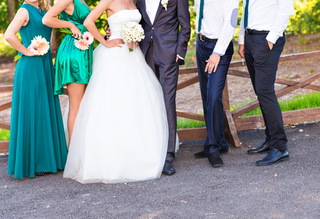 chose: wedding couple , groomsman and  bridesmaid posing in the park