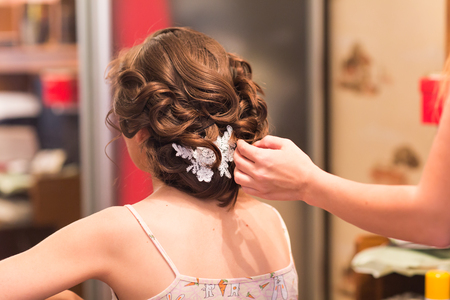 hair stylist: Hair stylist makes the bride before the wedding Stock Photo