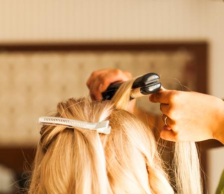 bride getting ready for wedding in hair dressing saloon.