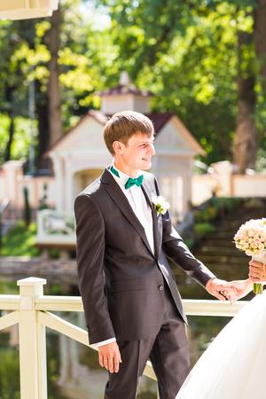 fingers put together: elegant stylish groom with bride. Wedding day