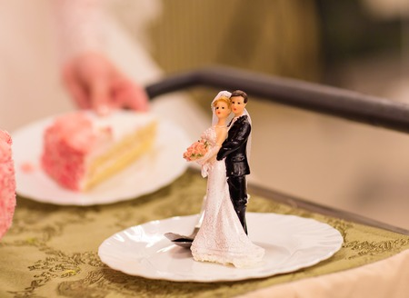 topper: Wedding cake figures of bride and groom Stock Photo
