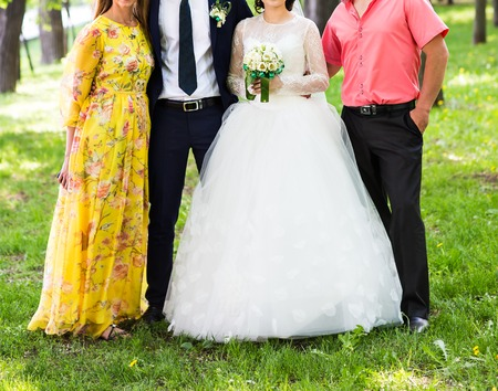 guests: Bride And Groom Celebrating With Guests outdoors