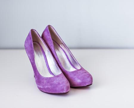 stilleto: New purple velvet high heel shoes on the table Stock Photo